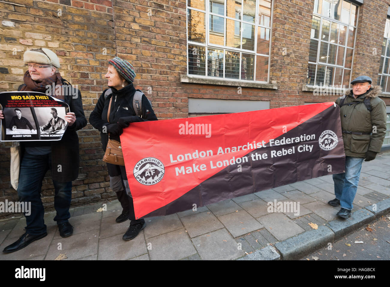 London, UK. 30th November 2016.  London Anarchist Federation banner at the protest outside the London offices of - Stock Image