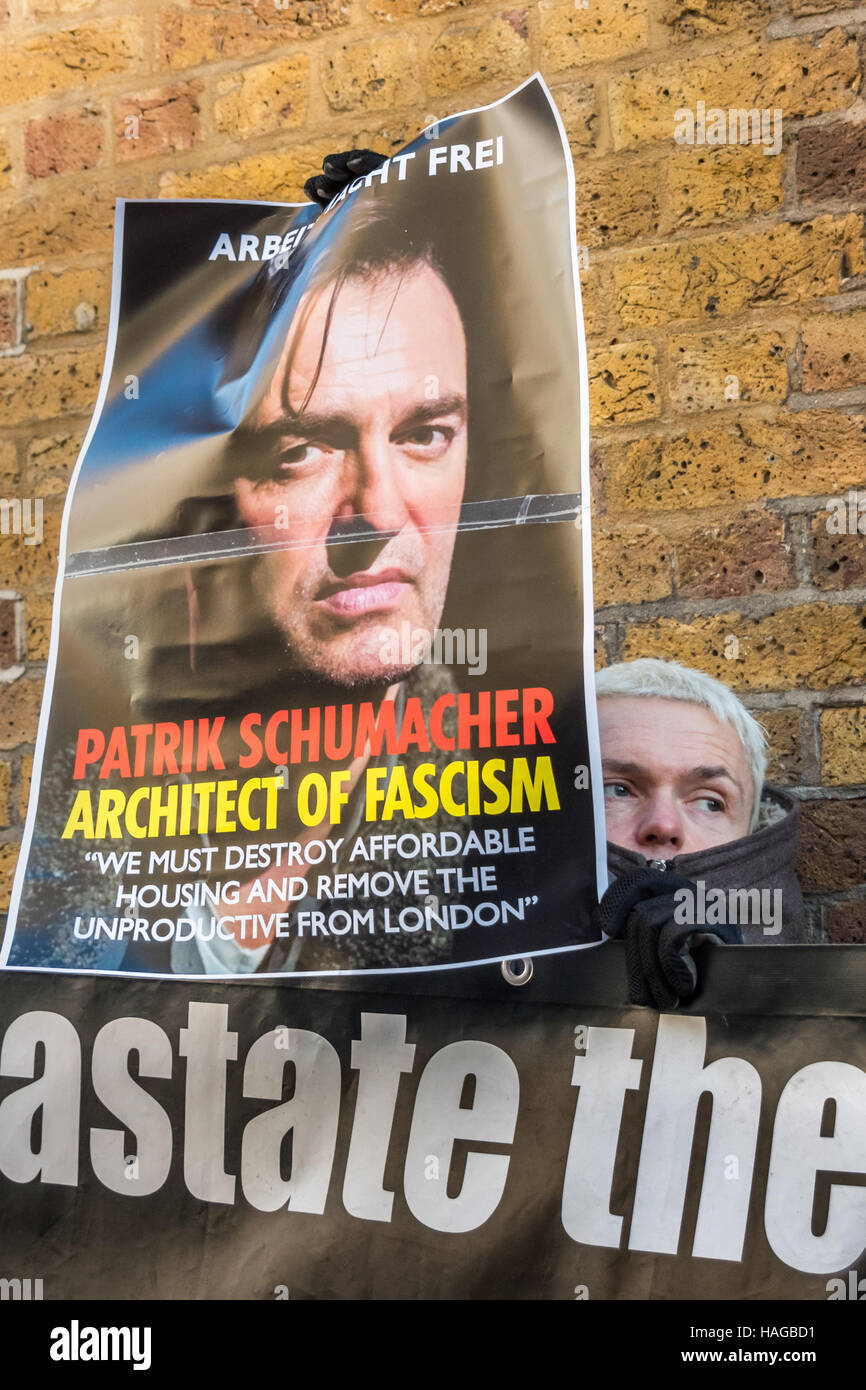 London, UK. 30th November 2016.  Sid Skill of Class War holds a poster showing Zaha Hadid Architects director Patrik - Stock Image