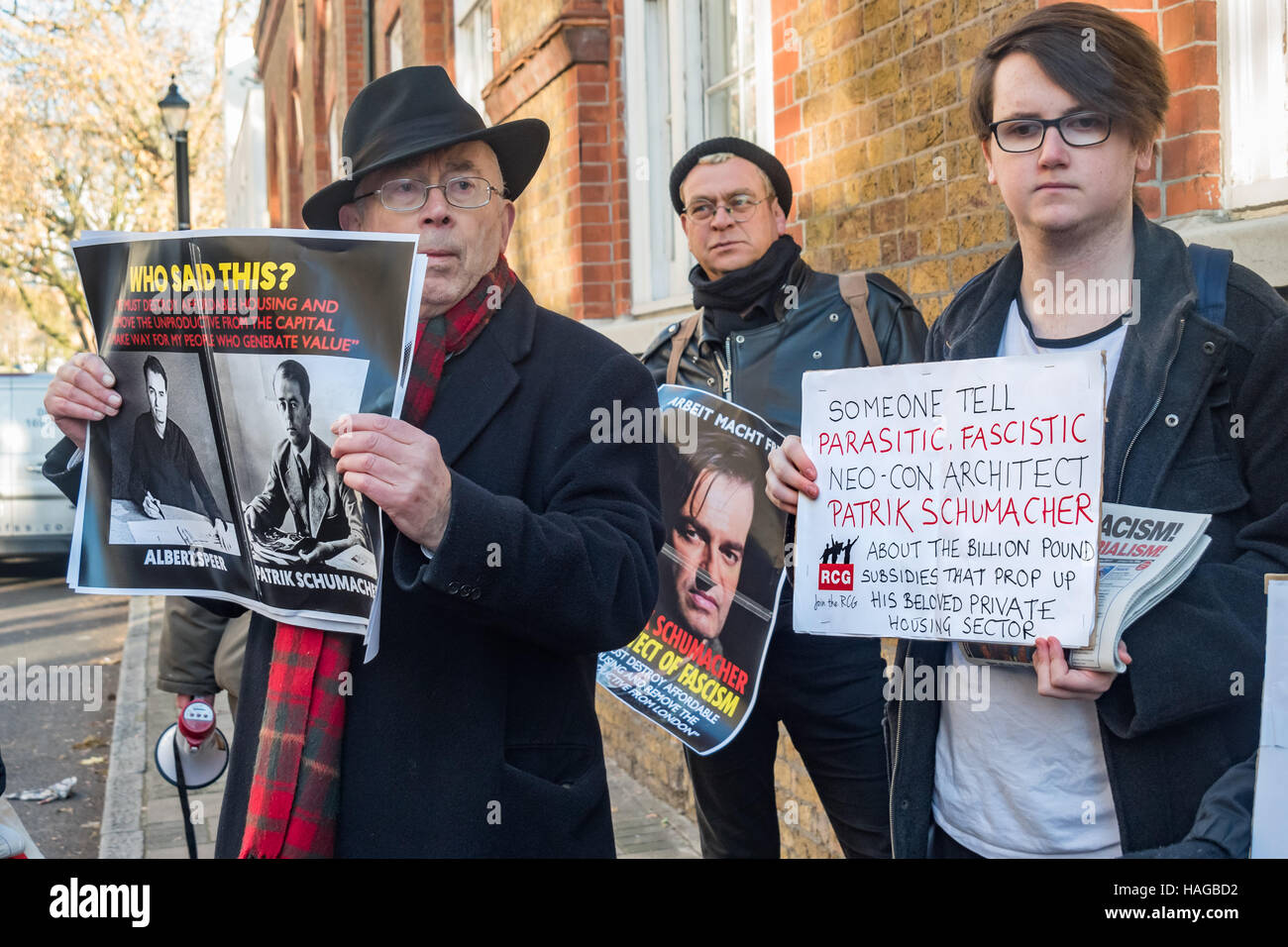 London, UK. 30th November 2016.  Ian Bone of Class War holds a poster comparing  Zaha Hadid Architects director - Stock Image