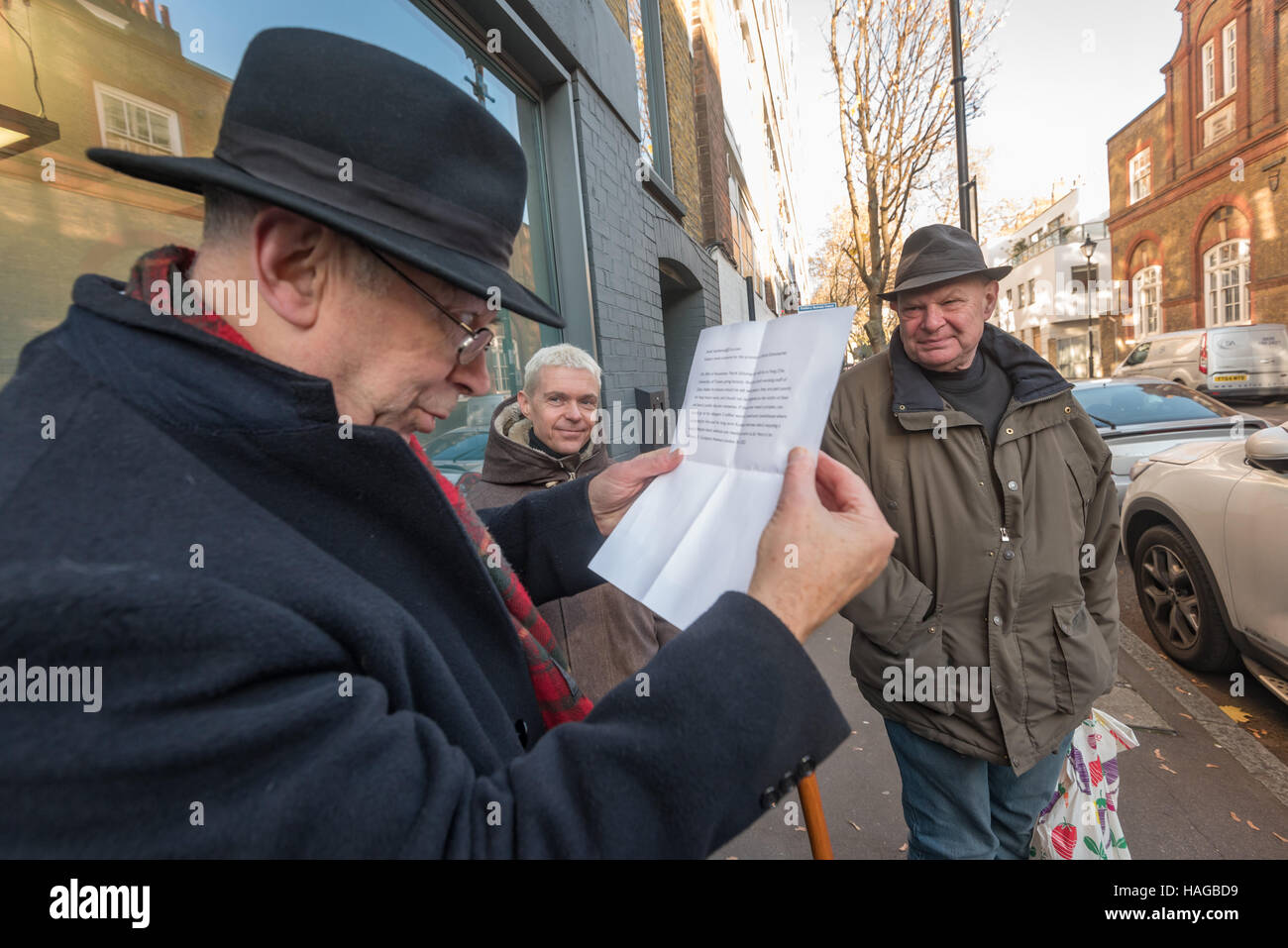 London, UK. 30th November 2016. Ian Bone of Class War reads an email apparently from a disaffected employee of Zaha - Stock Image
