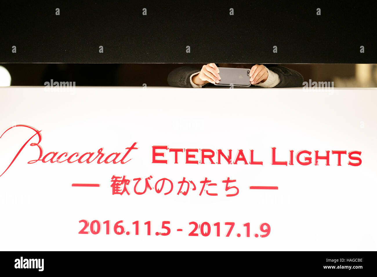 A woman takes pictures at Ebisu Garden Place on November 30, 2016, Tokyo, Japan. The Baccarat Eternal Lights is - Stock Image
