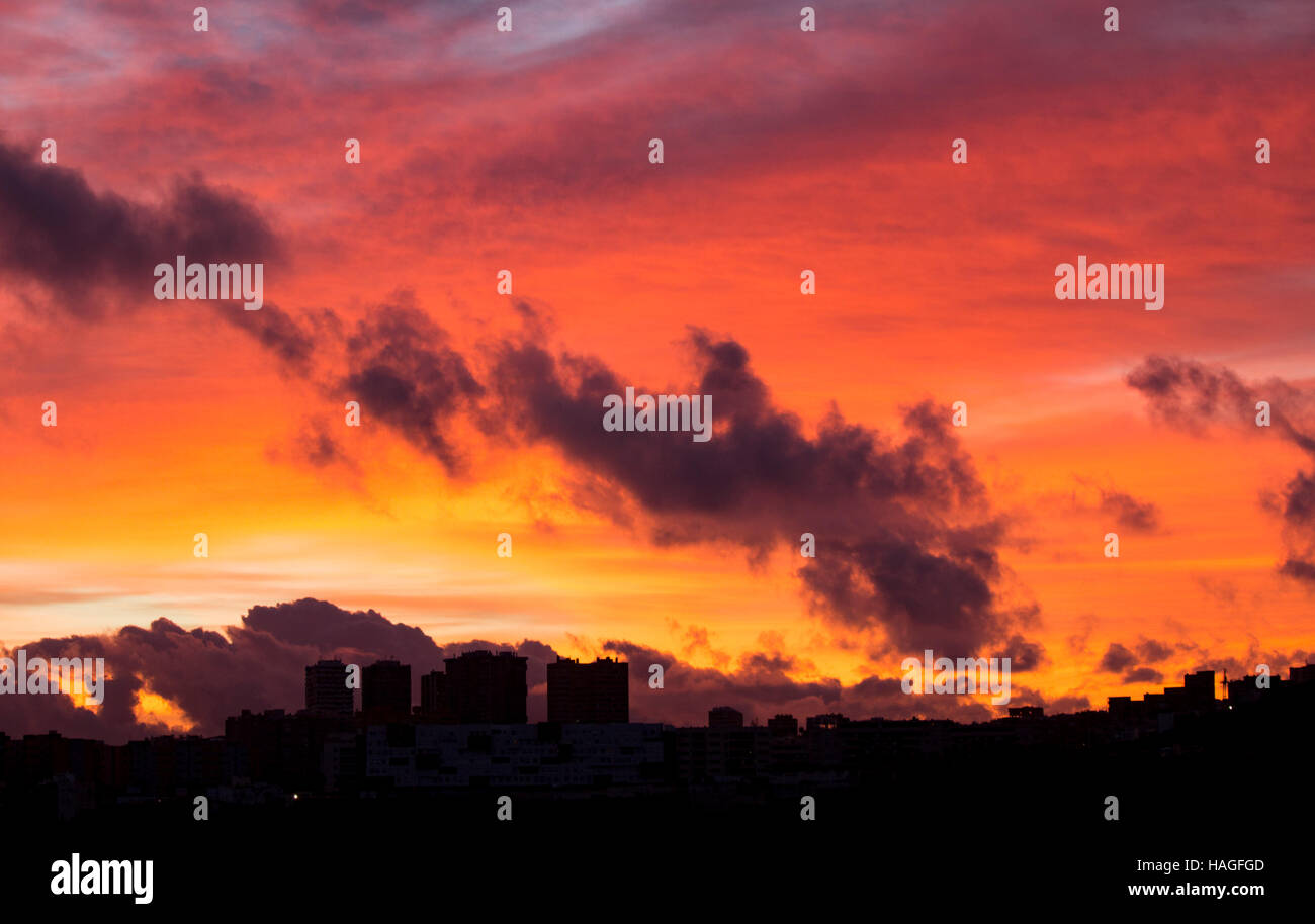 Las Palmas, Gran Canaria, Canary Islands, Spain. 1st December, 2016. Weather:  The sky explodes with colour at sunrise Stock Photo