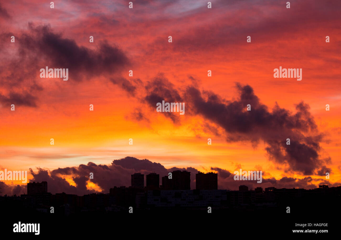 Las Palmas, Gran Canaria, Canary Islands, Spain. 1st December, 2016. Weather:  The sky explodes with colour at sunrise - Stock Image