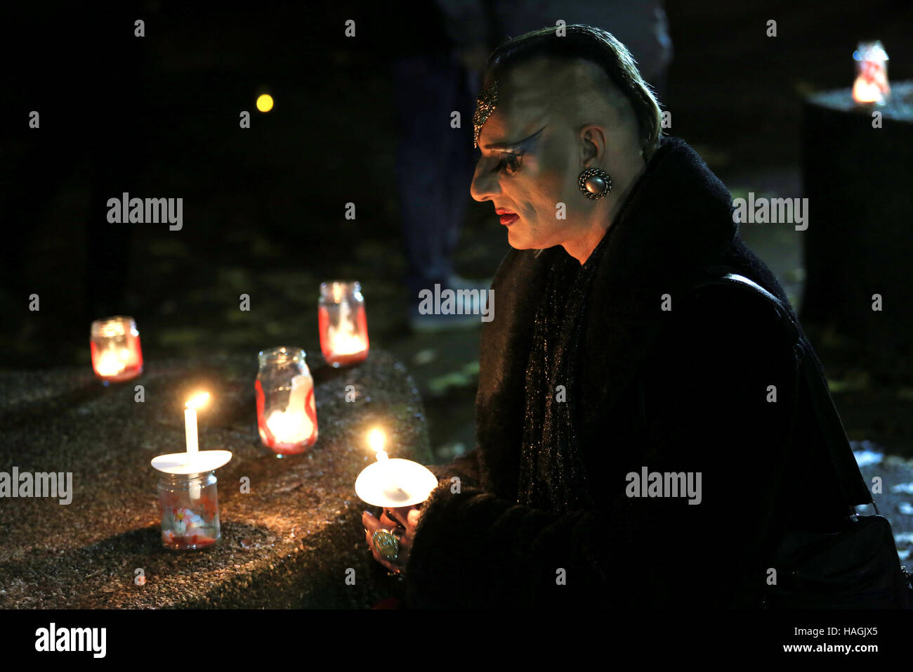A vigil for World Aids Day with a person with a candle, Sackville Gardens,Gay Village, Manchester, UK, 1st December, - Stock Image