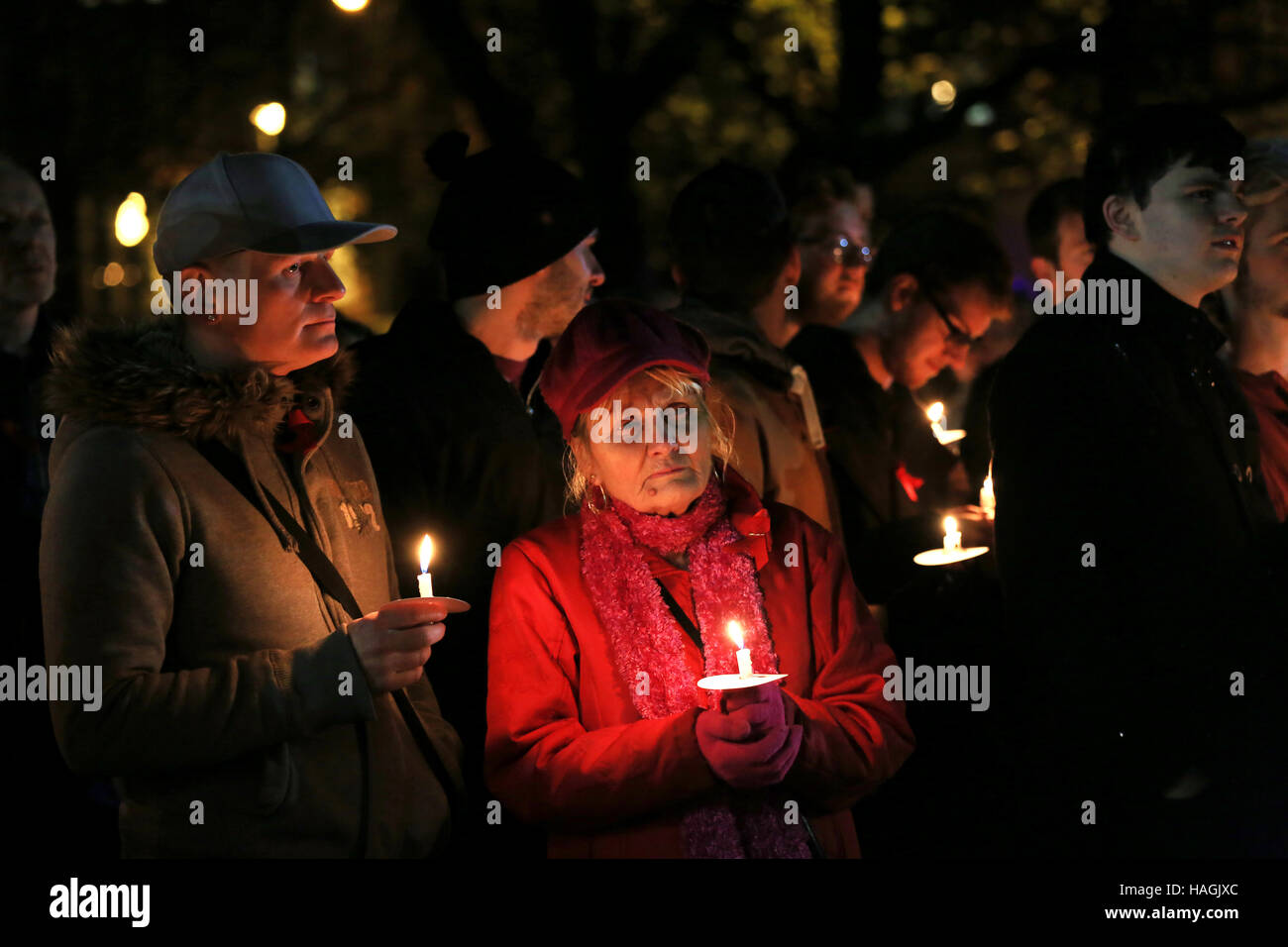 People with lit candles during a vigil on World Aids Day, Sackville Gardens,Gay Village, Manchester, UK, 1st December, - Stock Image