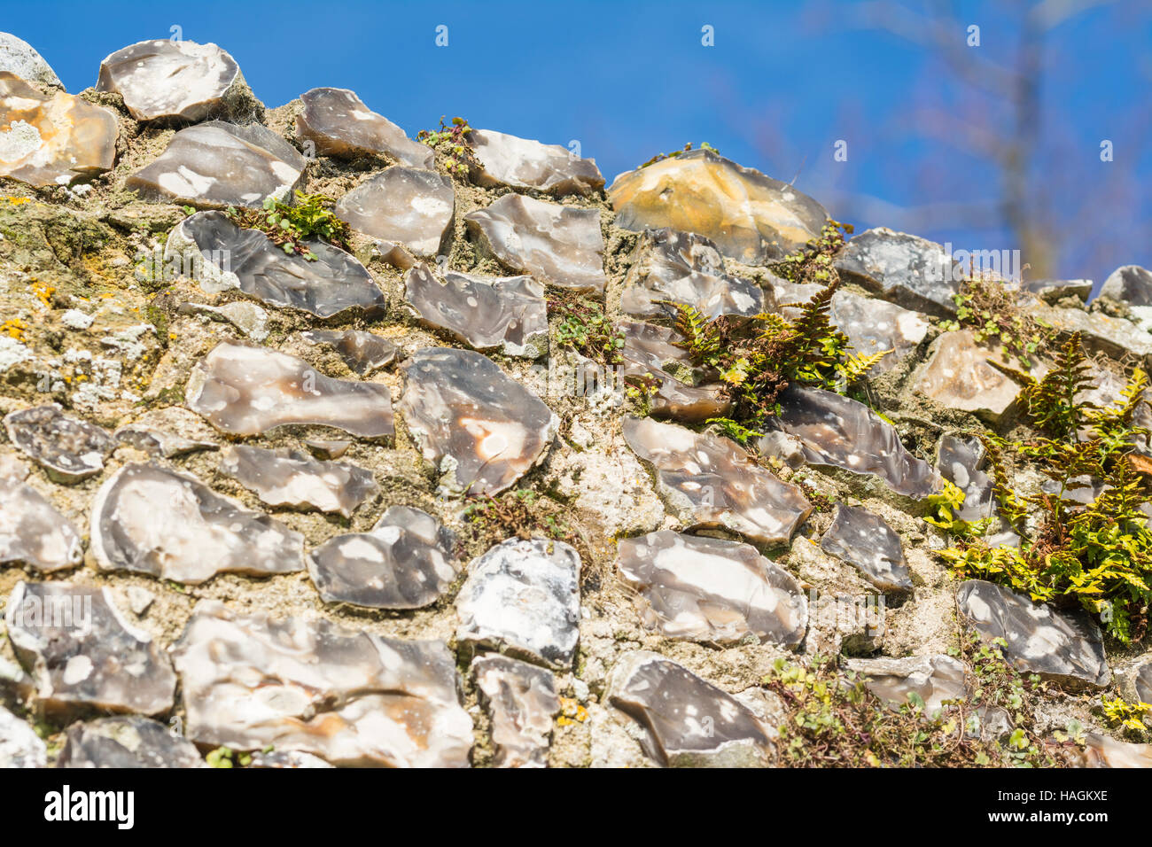 Flint wall on old ruins of a medieval building. - Stock Image