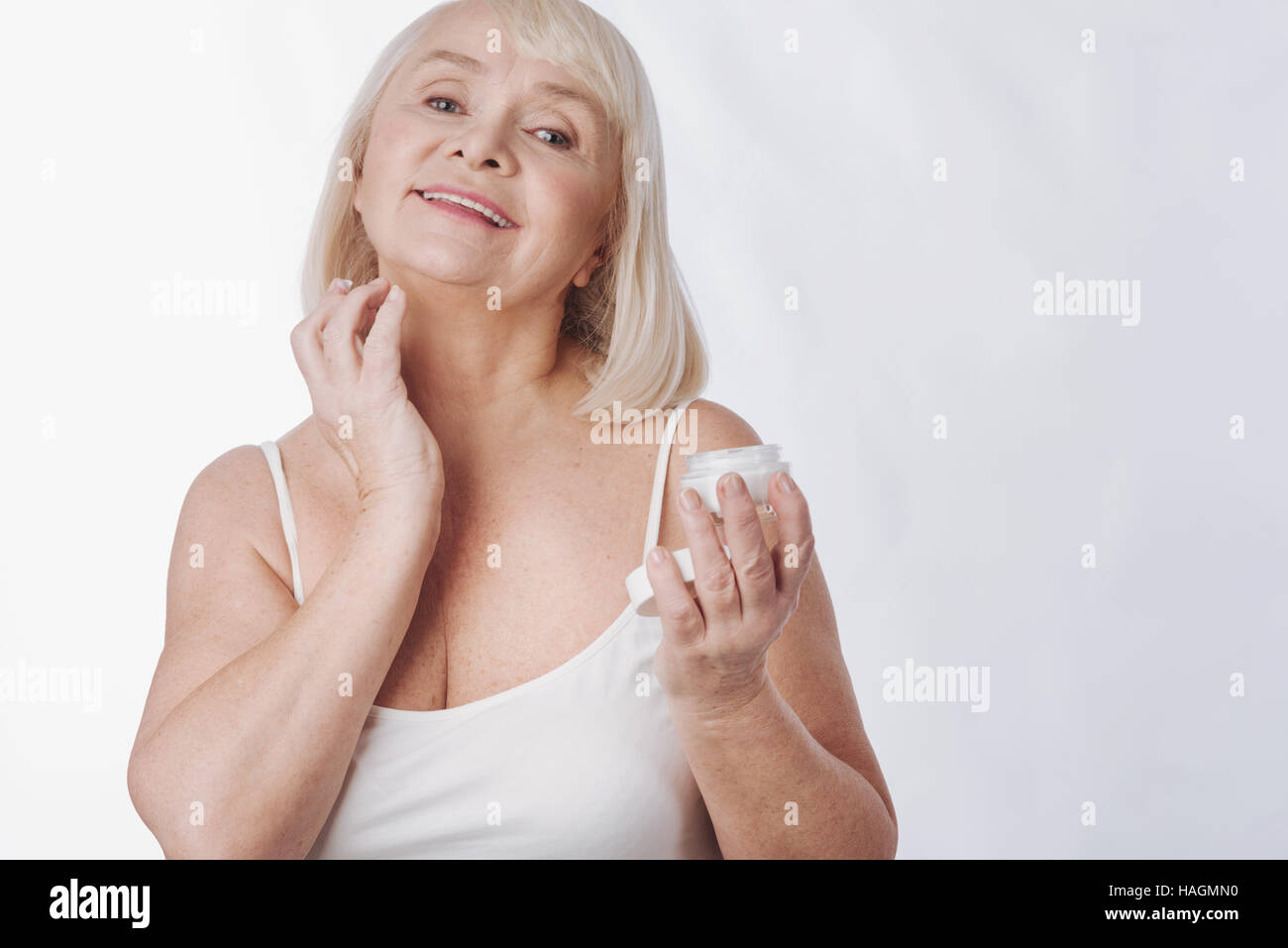 Pleasant nice woman fighting with age - Stock Image