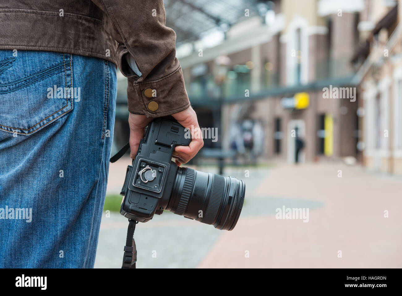 Photographer with camera in the city - Stock Image