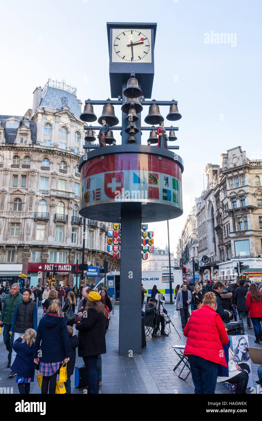 The Swiss Glockenspiel, a musical clock featuring 27 bells and 11 moving Swiss figures, Leicester Square, London, - Stock Image