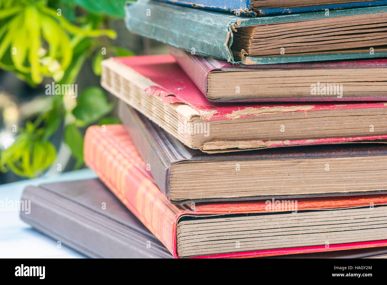 Stack of old stamp album in close up view. - Stock Image