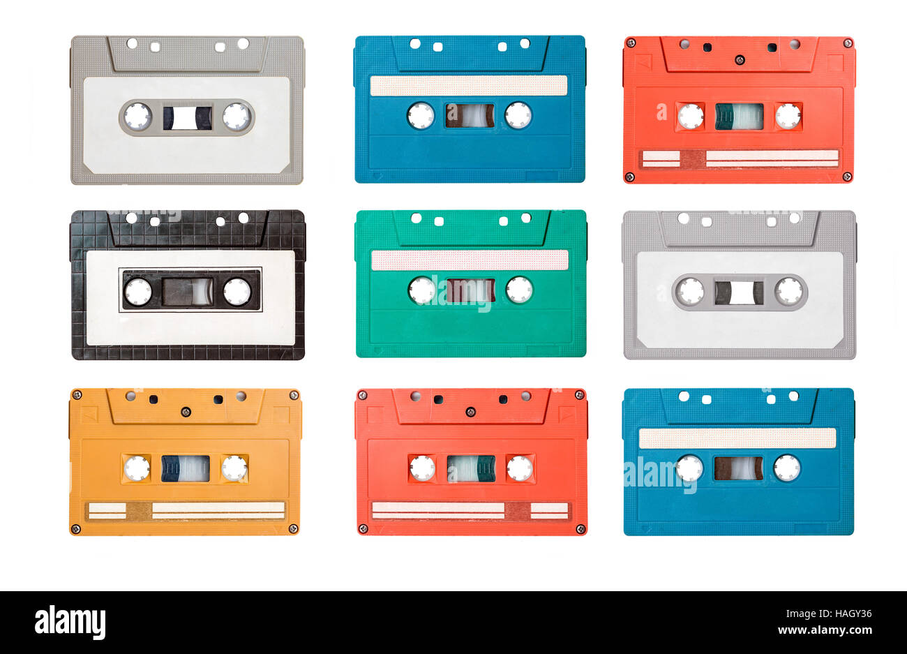 collection of retro cassette tapes on white background - Stock Image