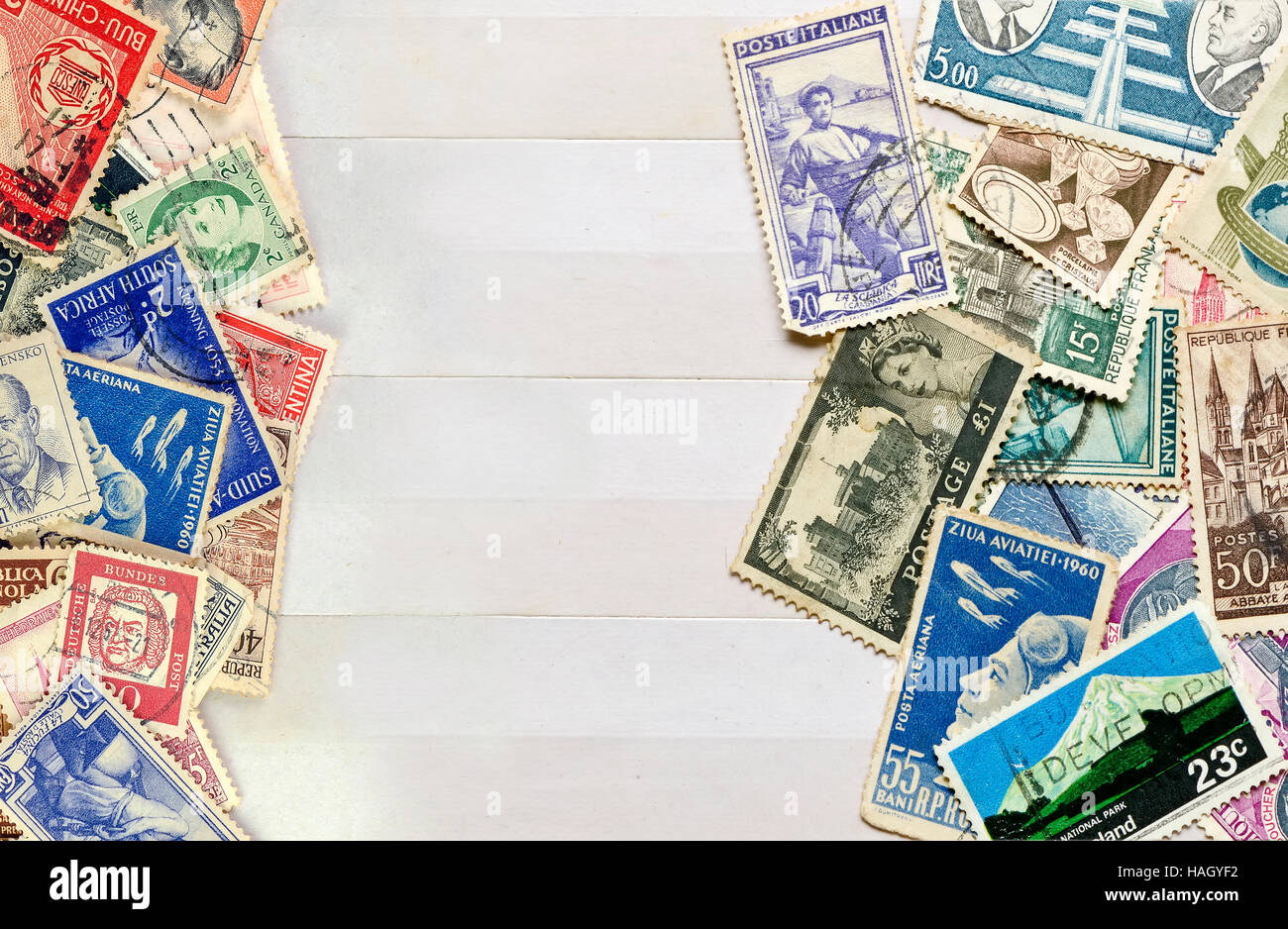 Used stamps mail of  different countries on the book collecting stamps page. - Stock Image