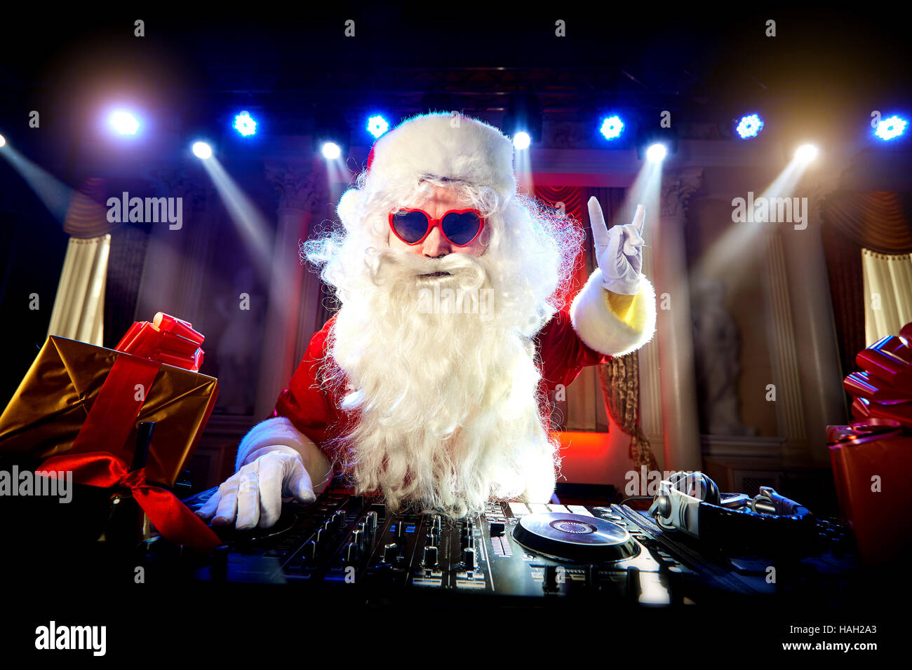 dj santa claus mixing at the party christmas stock photo. Black Bedroom Furniture Sets. Home Design Ideas
