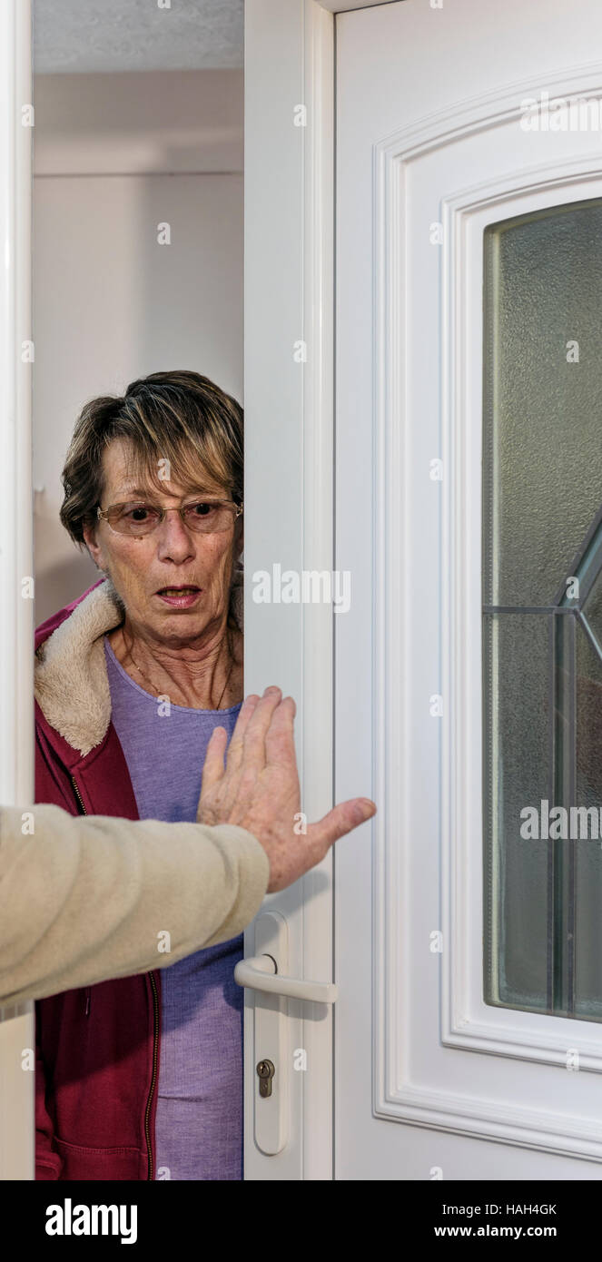 Lady shocked by an intruder.Forced entry. - Stock Image