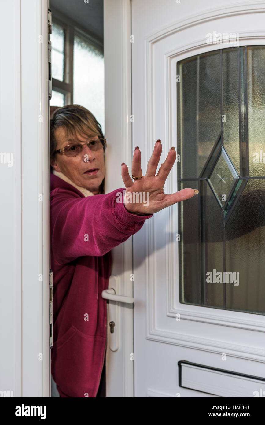 Lady attempting to push away an intruder. Stock Photo
