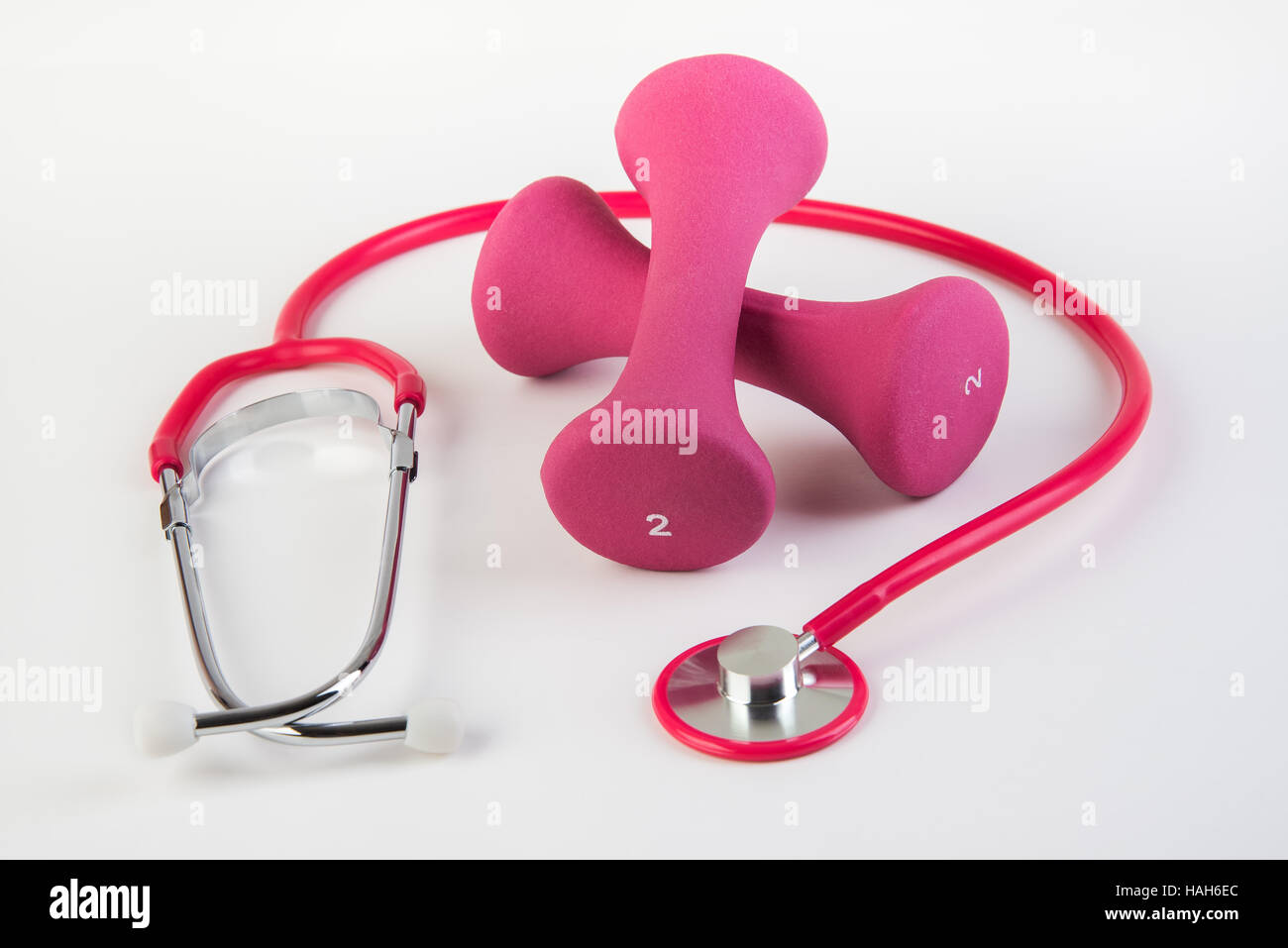 Workout and regular checkups at doctor for safe health - Stock Image