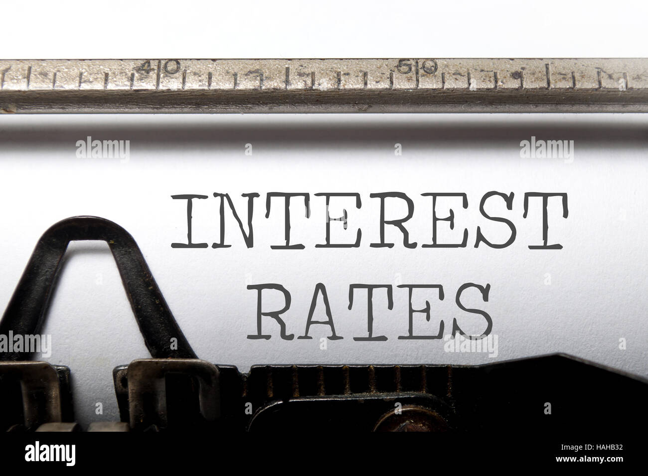 Interest rates headline printed on an old typewriter - Stock Image