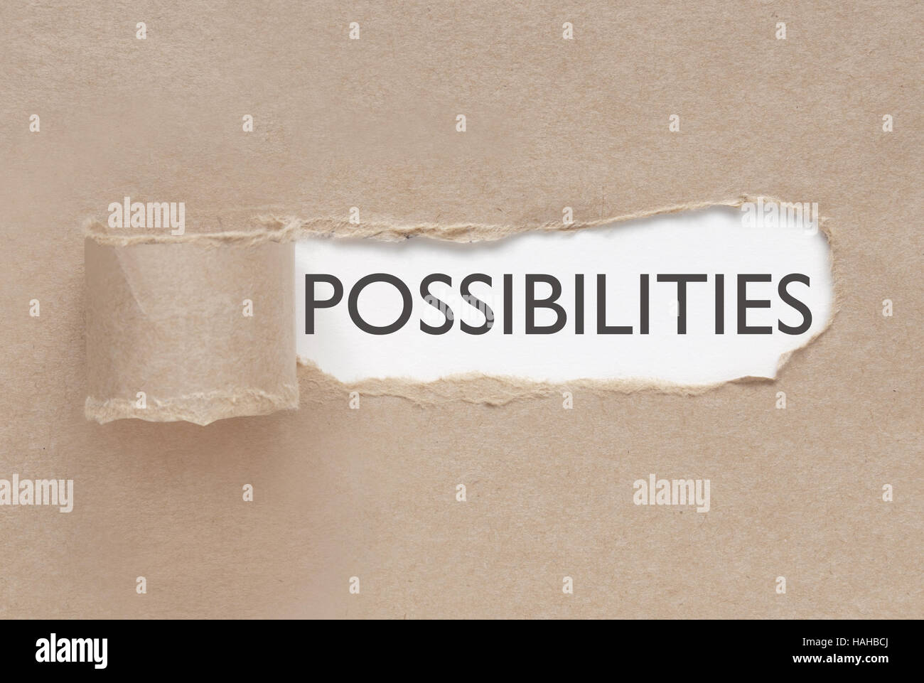 Torn paper revealing the word possibilities - Stock Image