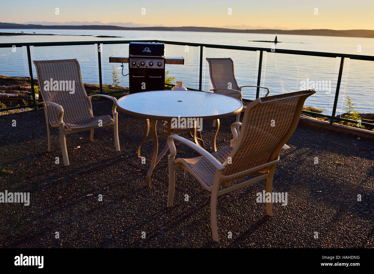 A table and chairs waiting for people to sit and relax - Stock Image