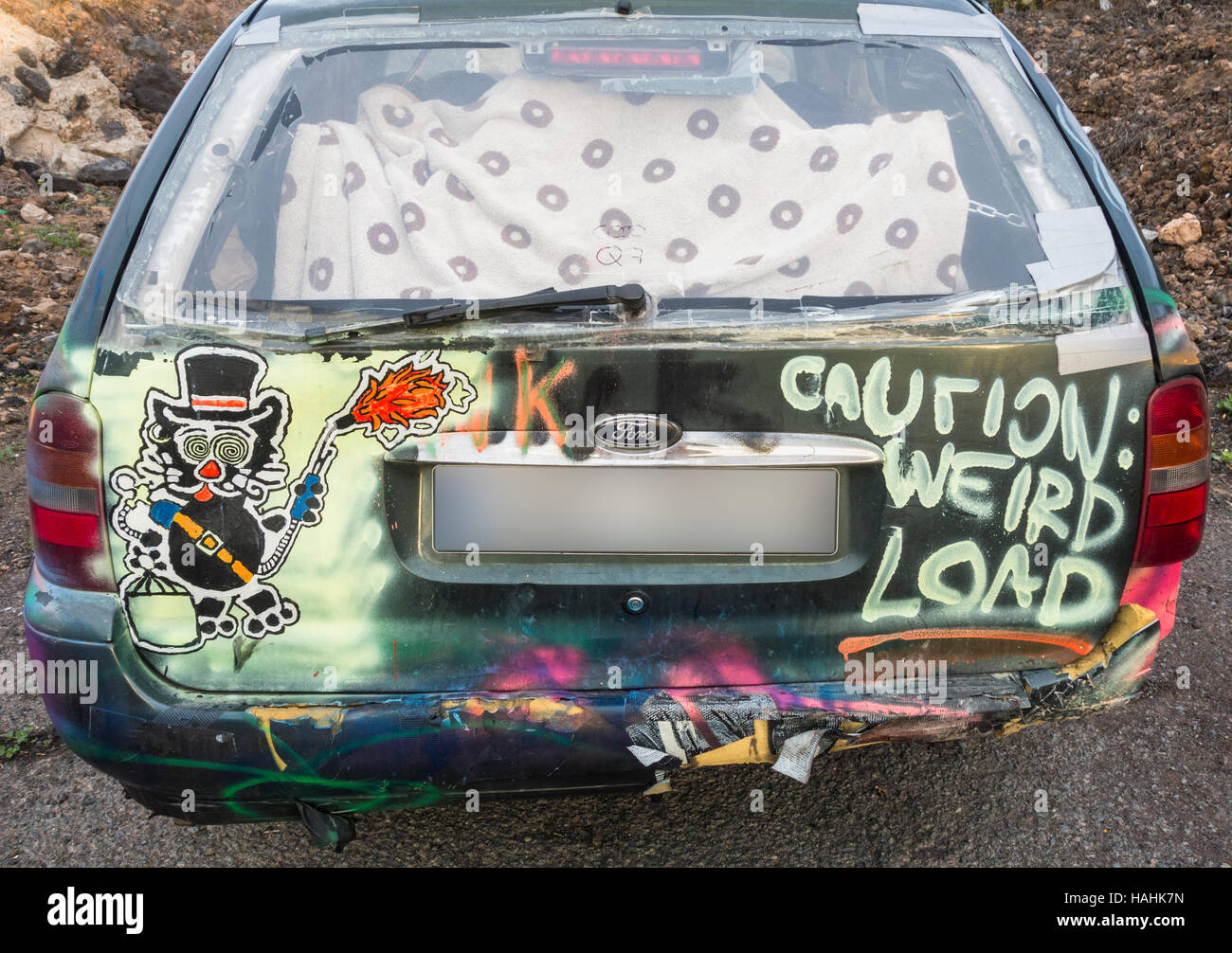 Caution weird load painted on car. - Stock Image
