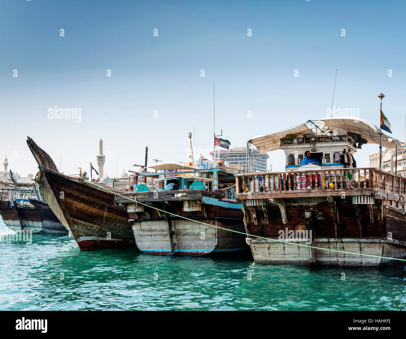 traditional old arabian wood dhow boats in deira harbour of dubai port UAE - Stock Image