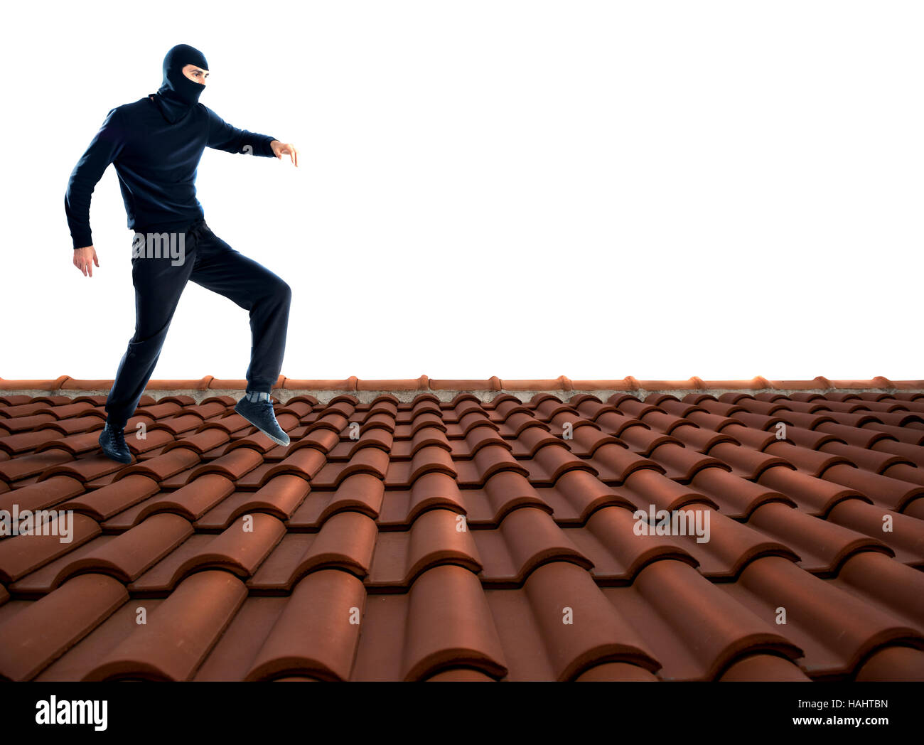 Thief on the roof - Stock Image