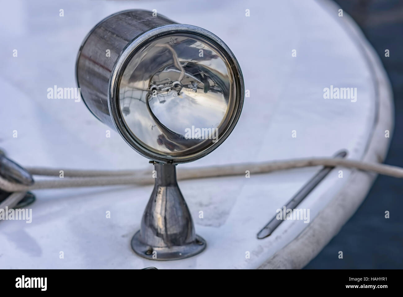 Spotlight on front of pleasure boat - Stock Image