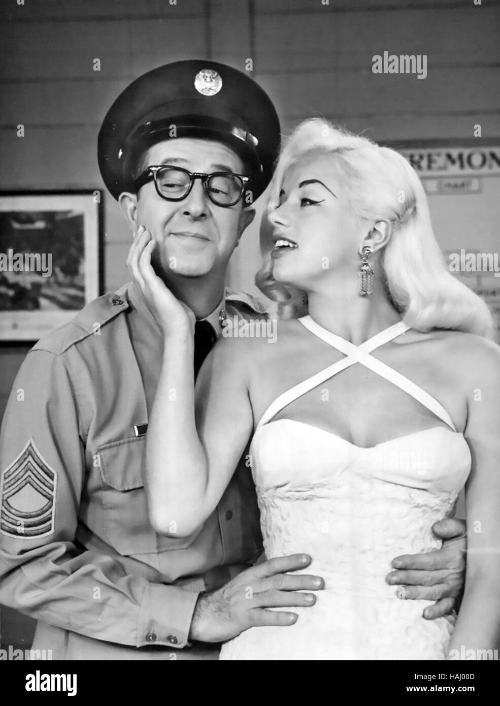 PHIL SILVERS US film and TV actor on his 1958 CBS TV show with Diana Dors - Stock Image