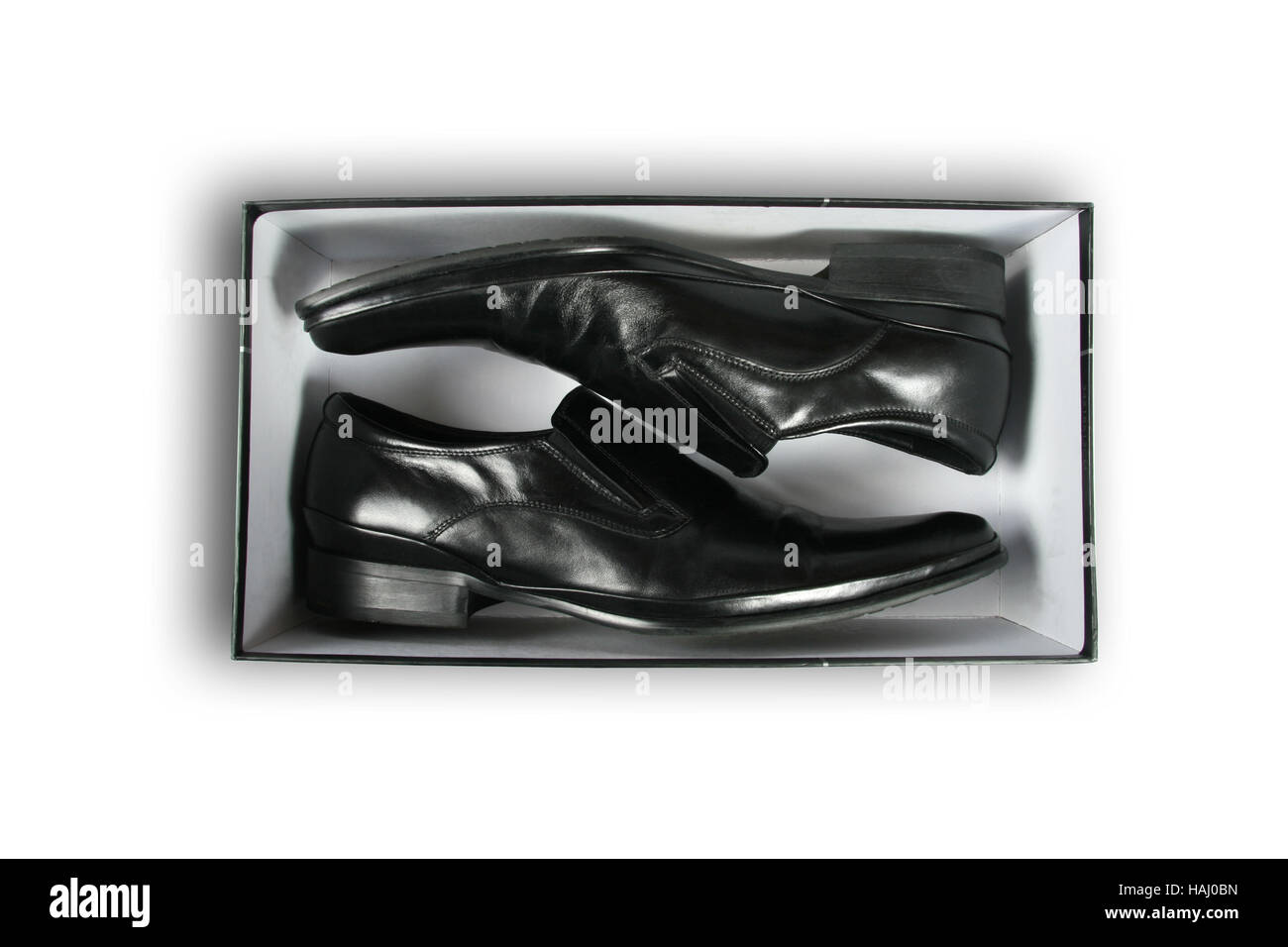 Pair of black leather shoes inside a box - Stock Image