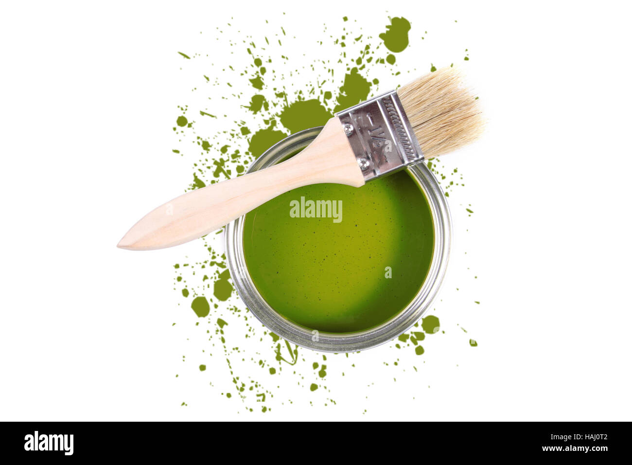Green paint can with brush and color stains - Stock Image