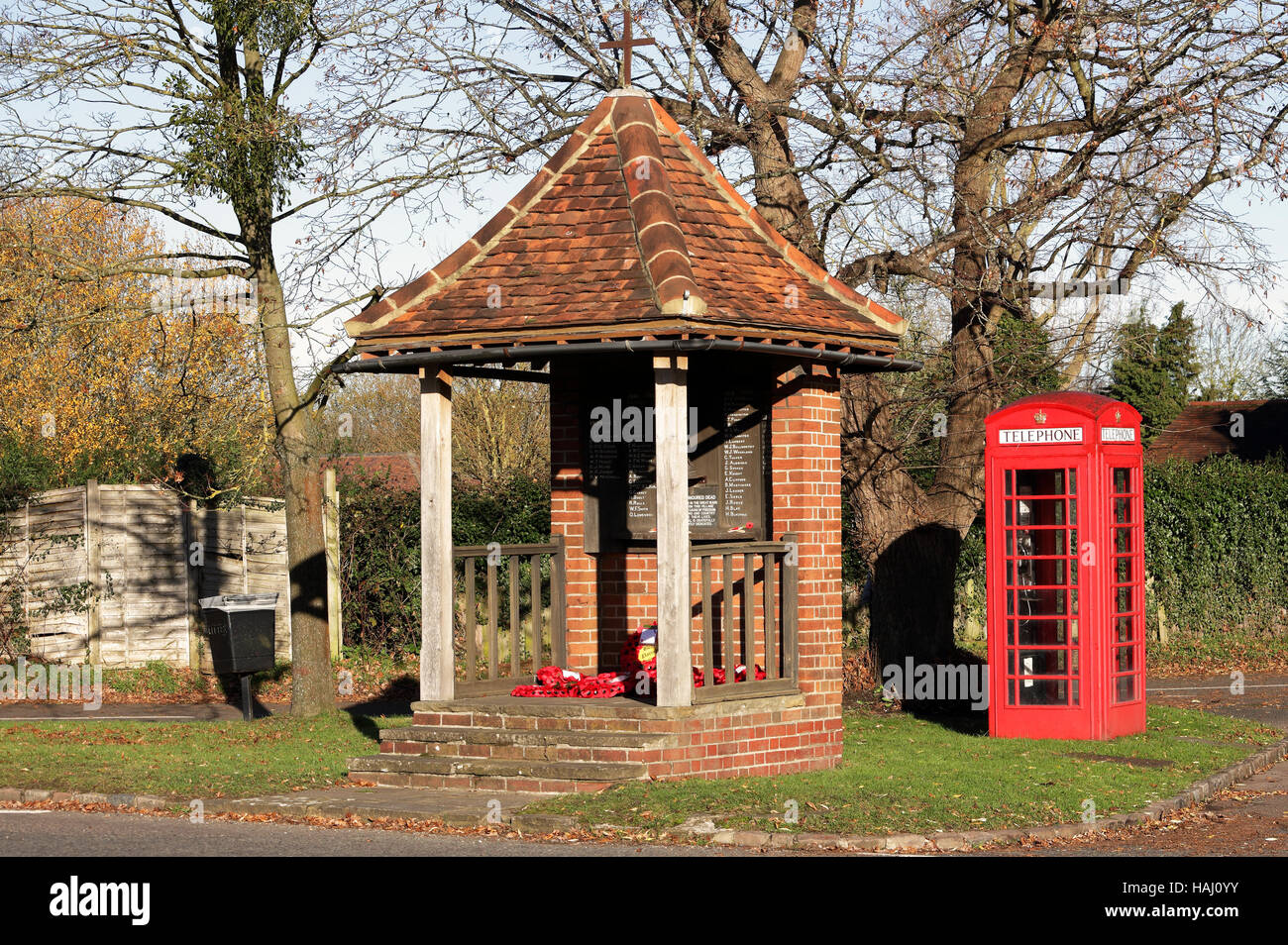 English Village green with War Memorial and telephone box Stock Photo