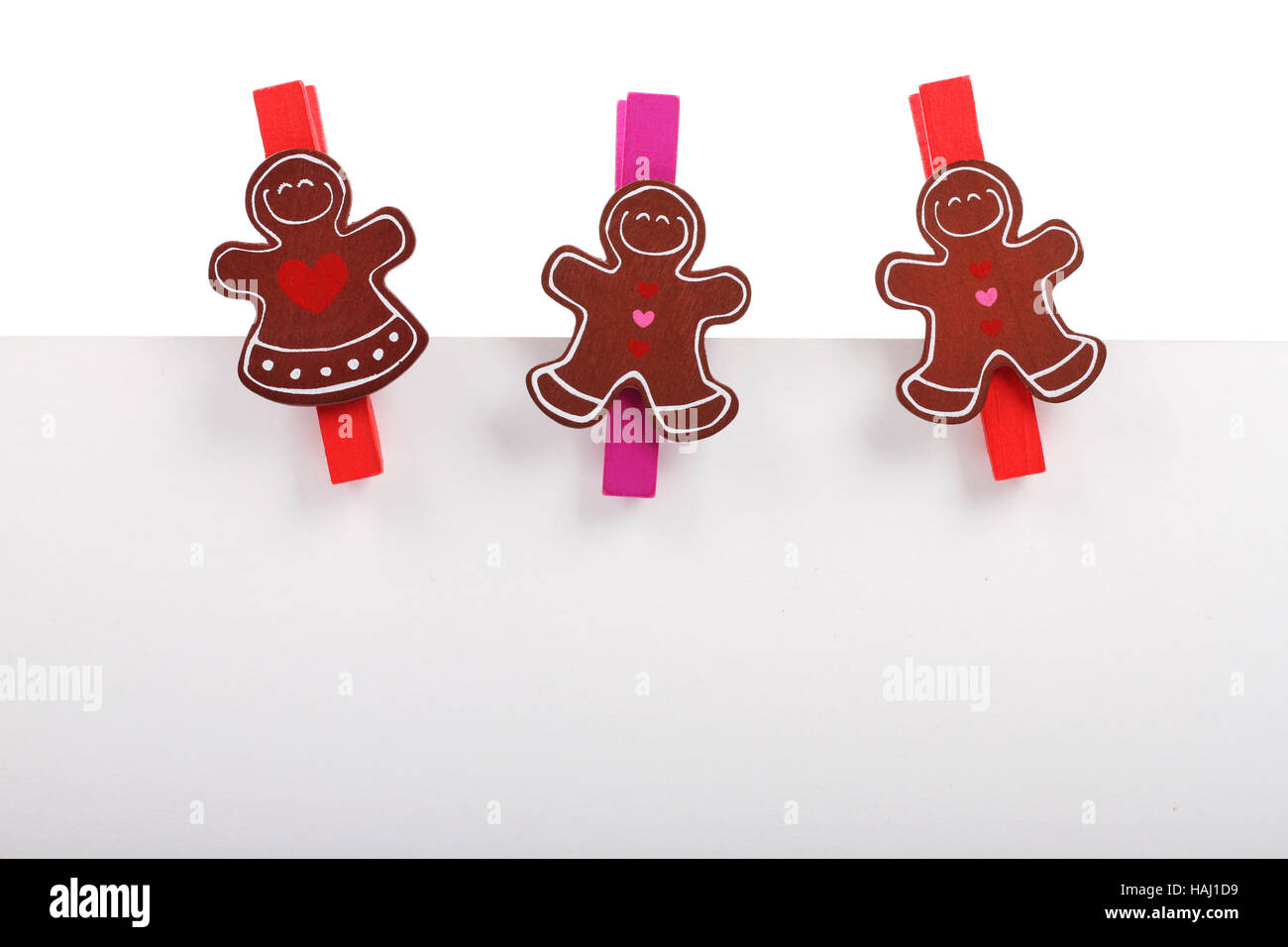 three pegs attached to a blank paper - Stock Image
