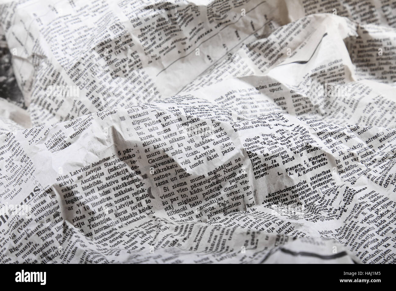 background of old crumpled newspaper - Stock Image