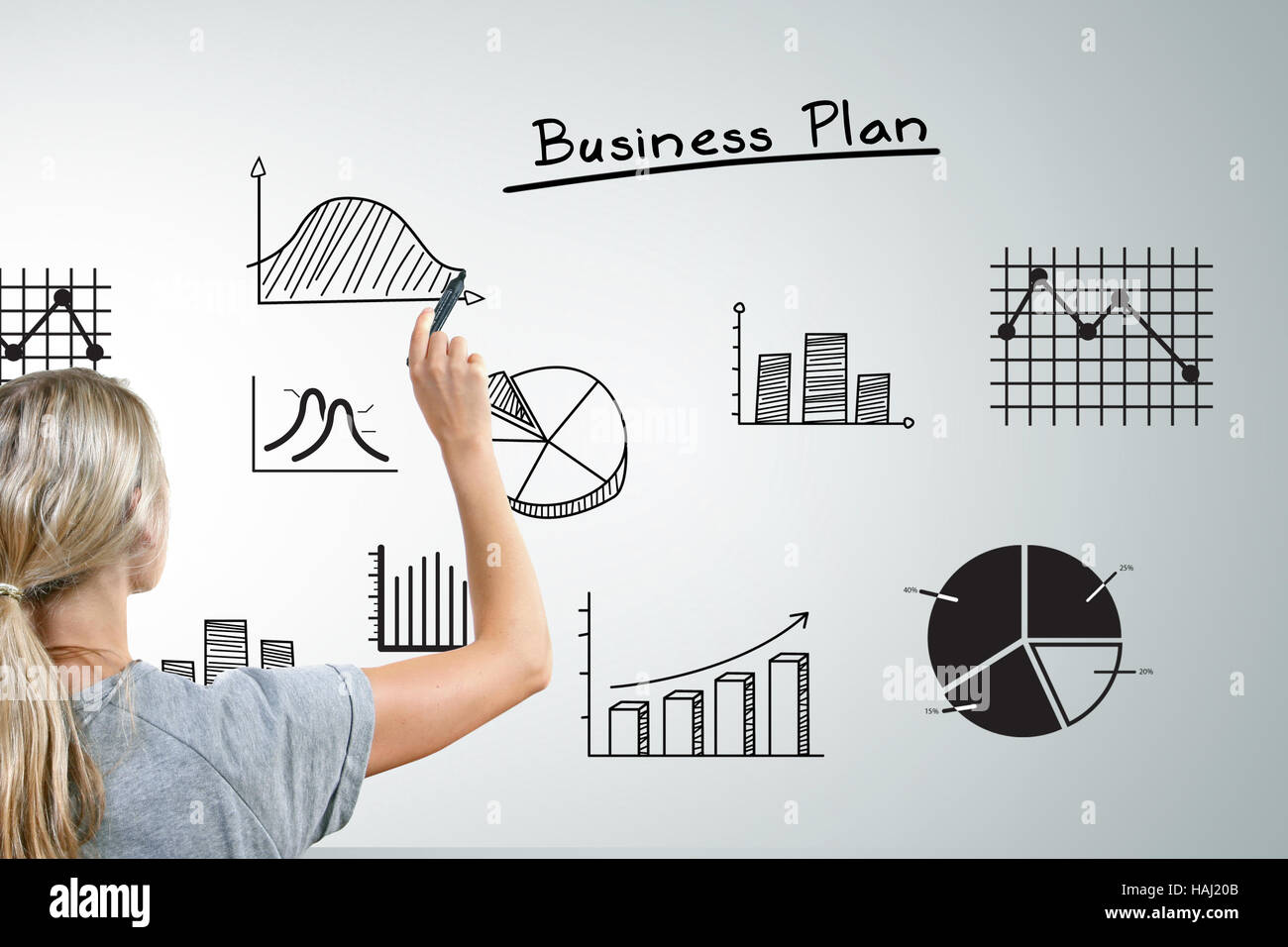 woman drawing different business plan graphs and charts stock photo