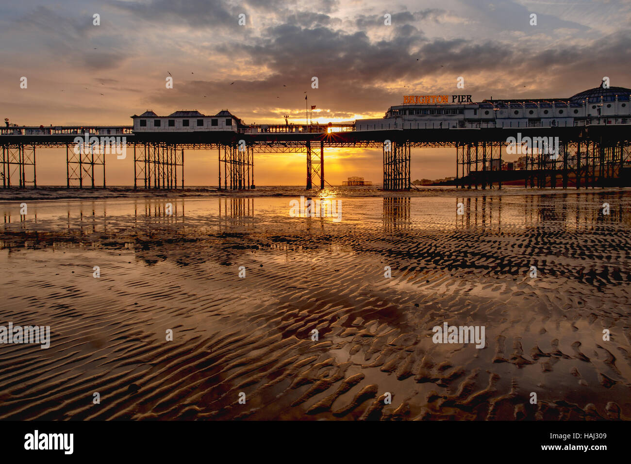 Low tide at Brighton Pier - Stock Image