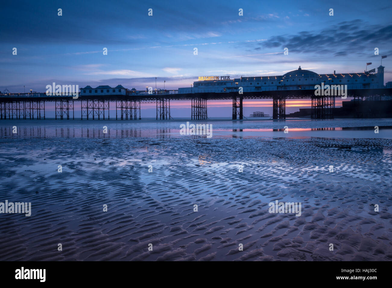 Low tide near Brighton Pier - Stock Image