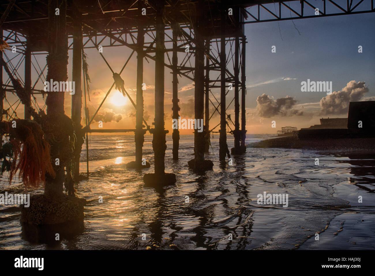 Under the Brighton Pier sunset - Stock Image