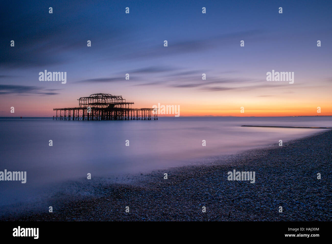 Calming sunset at the West Pier - Stock Image