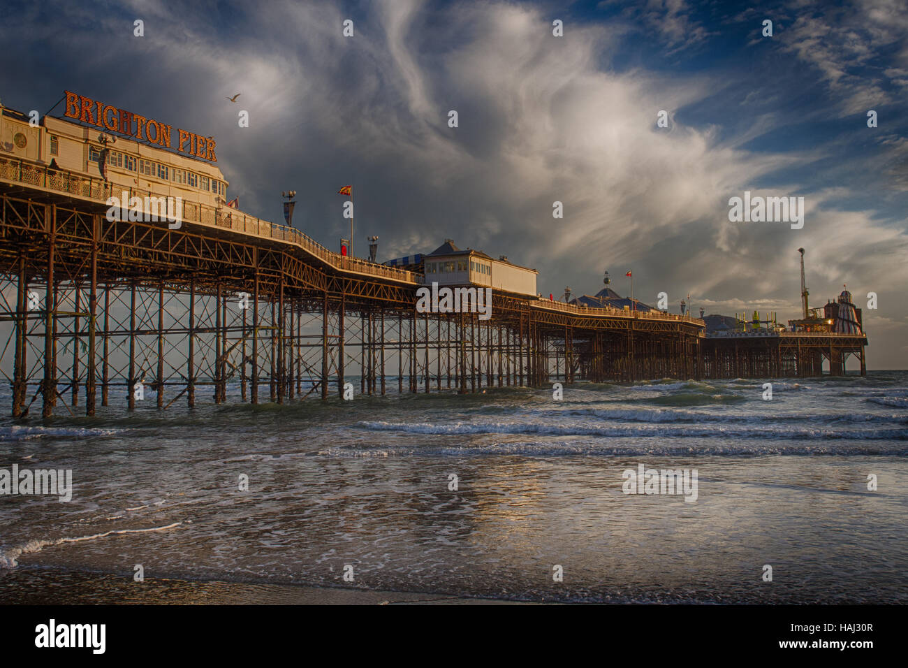 Brighton Pier with dramatic clouds - Stock Image