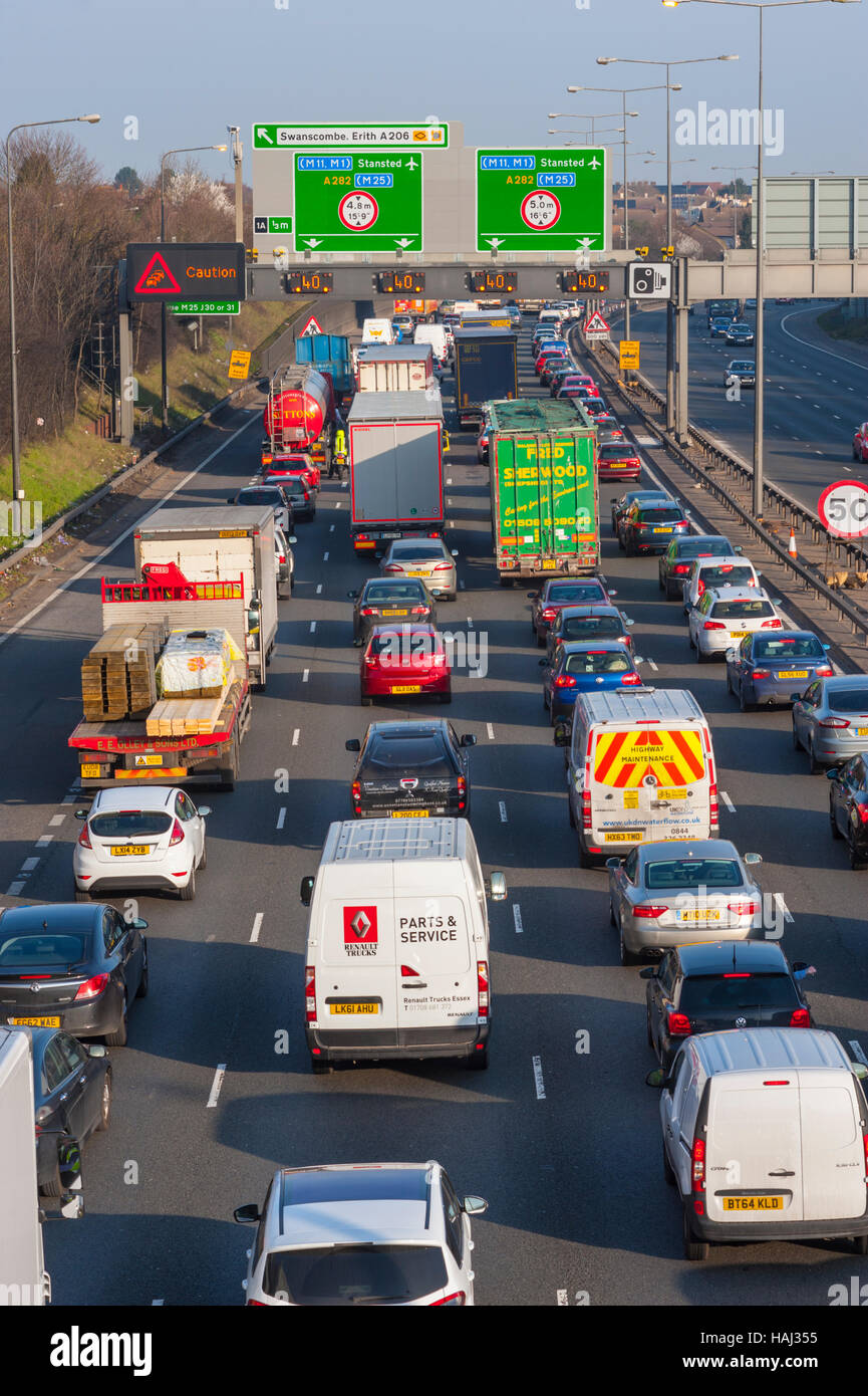 Traffic queueing on the approach roads towards the Dartford crossing with 40MPH speed limit and caiution signs showing. - Stock Image