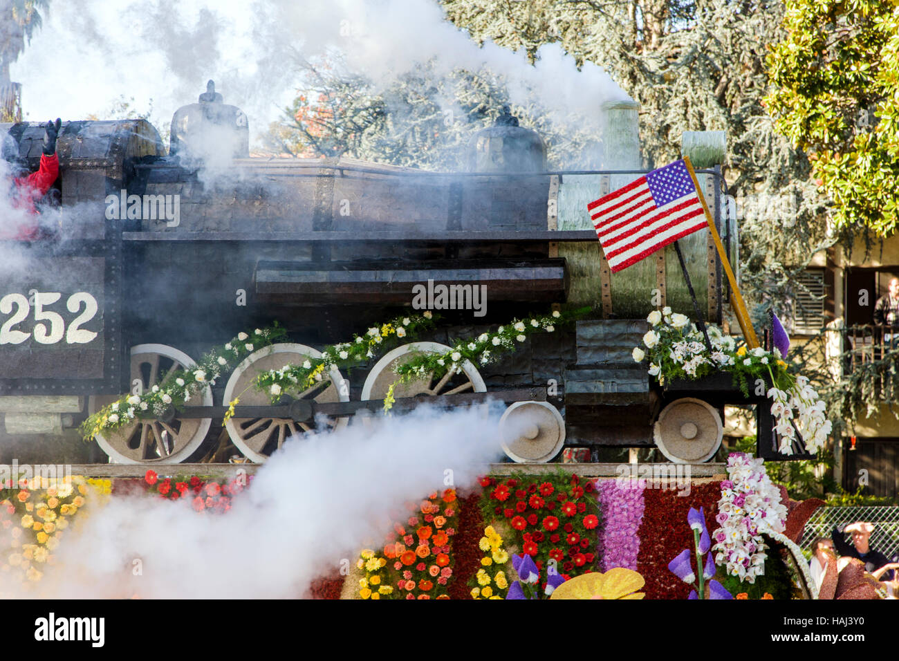Float decorated like steam locomotive with flowers in the annual New Years Day Rose Bowl Parade, Pasadena, California, Stock Photo