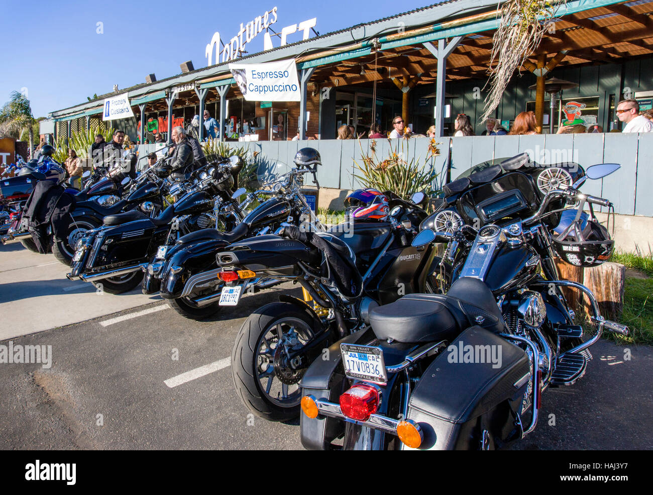 Harley Davidson motorcycles parked in front of the Neptune's Net Seafood Restaurant on Rt. 1 in Malibu, California, - Stock Image