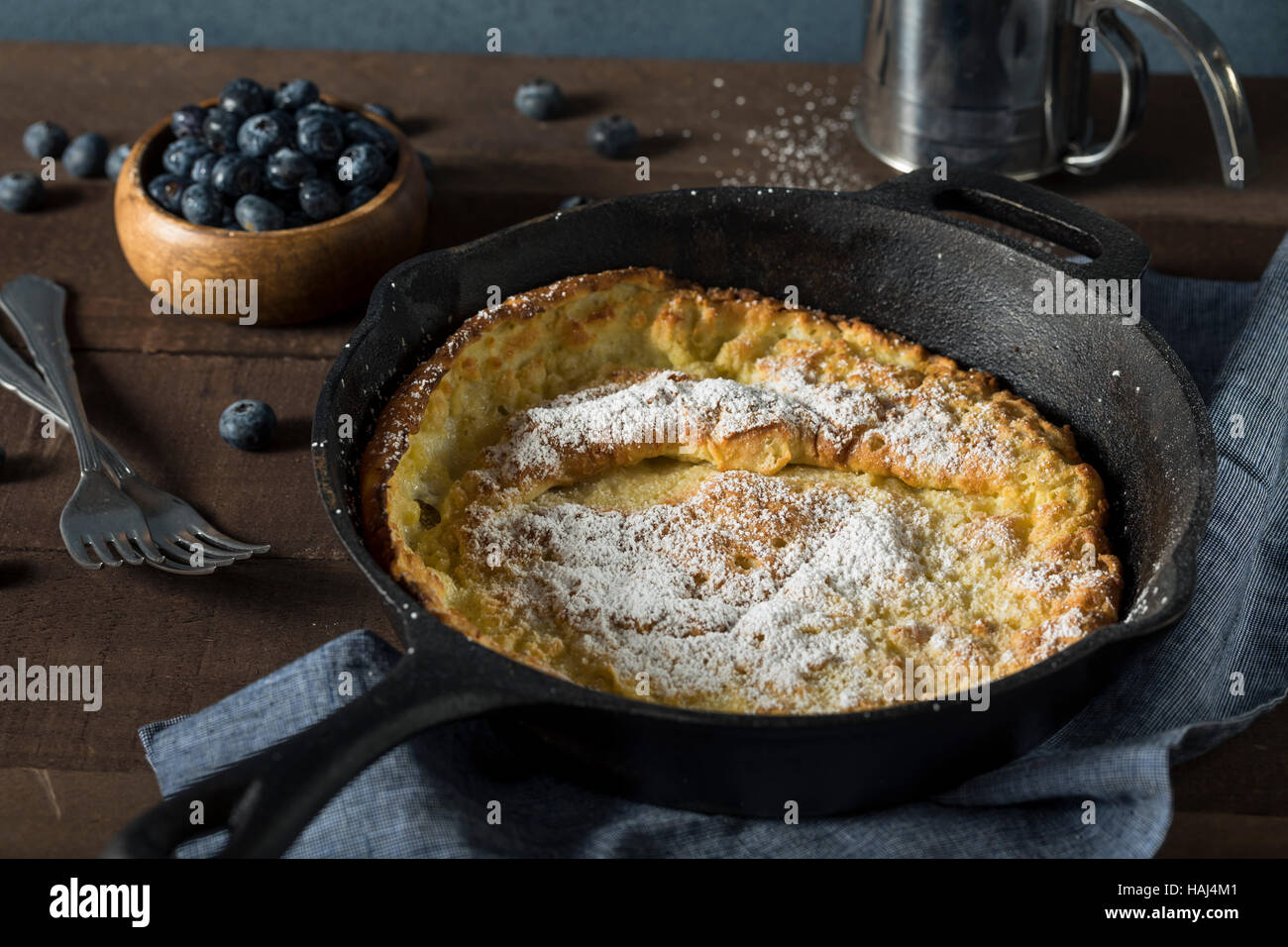 Homemade Dutch Baby Pancake with Blueberries and Powdered Sugar - Stock Image