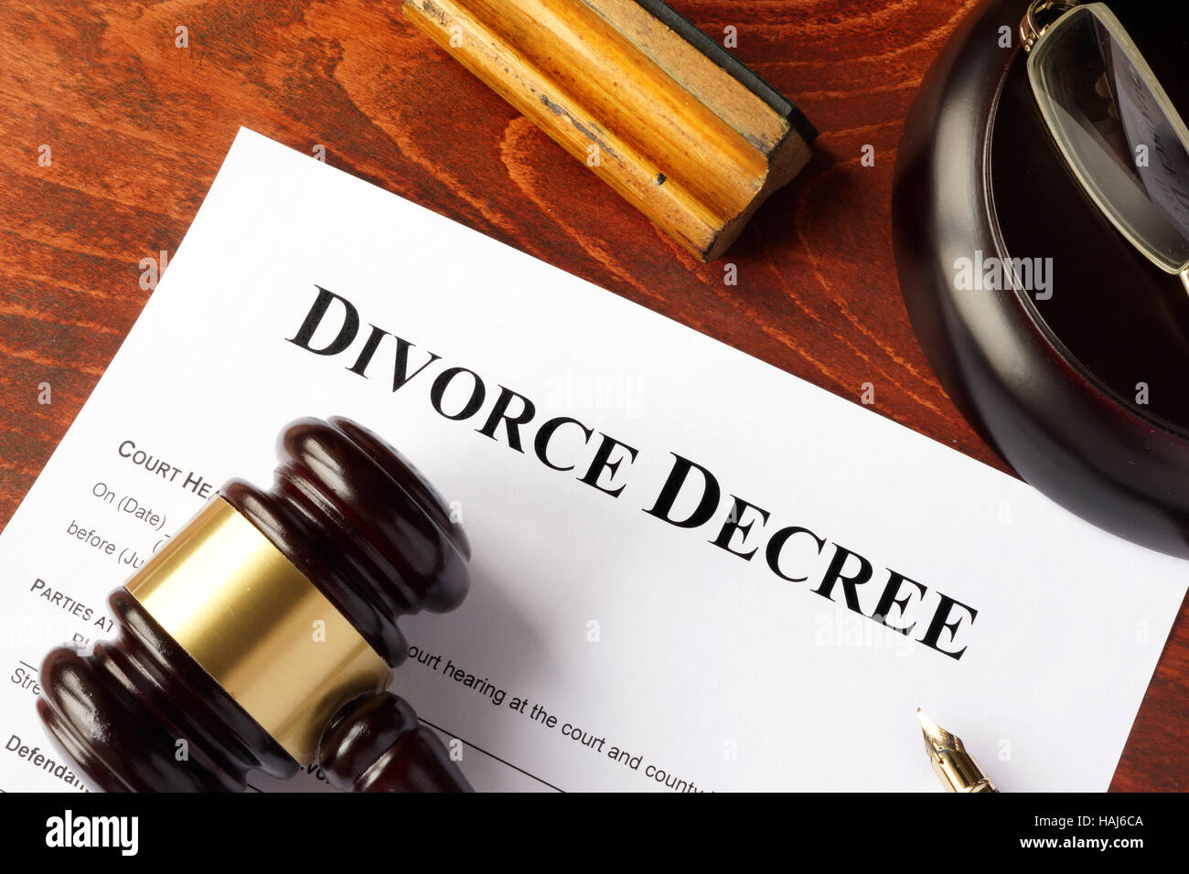Divorce decree and gavel on a table. - Stock Image