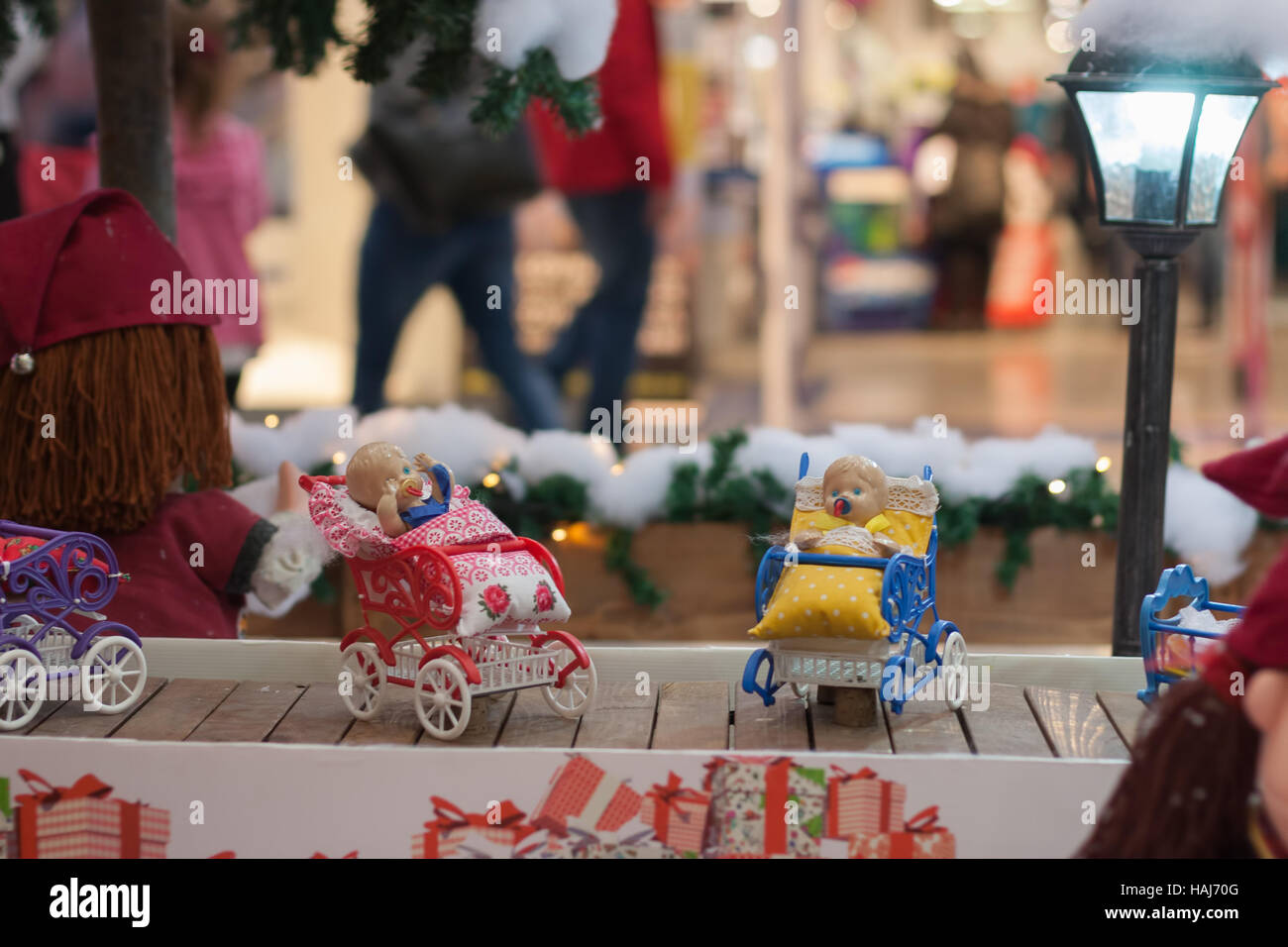 BRNO,CZECH REPUBLIC-NOVEMBER 19,2016:Miniature doll buggies on conveyor belt  at shopping center Olympia on November - Stock Image