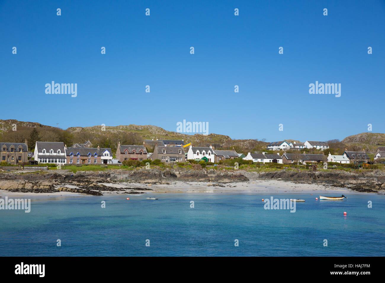 Island village on Iona Scotland uk Inner Hebrides off the Isle of Mull west coast of Scotland clear blue sea - Stock Image