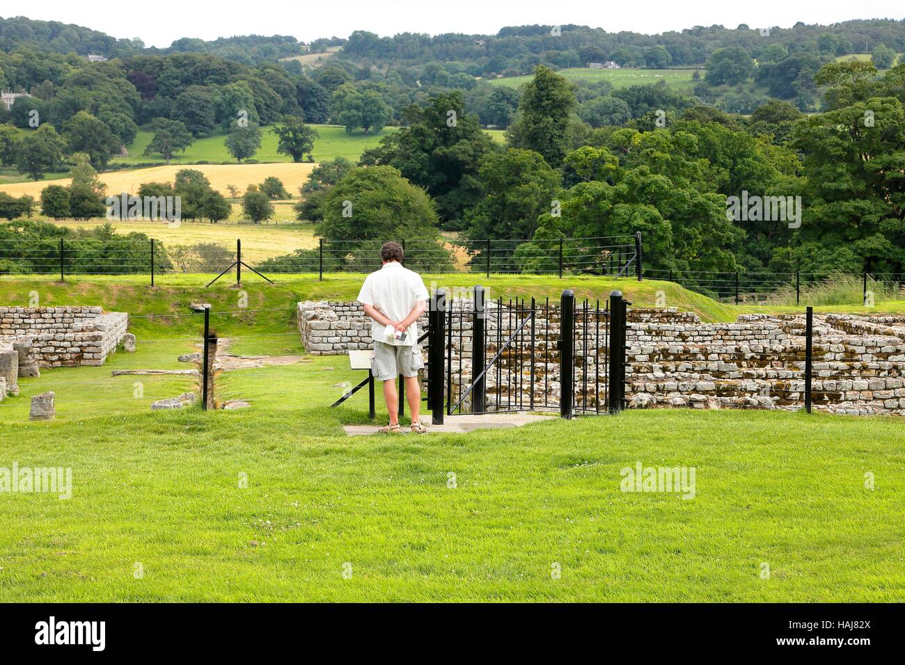 Tourists looking at ruins. Chesters Roman Fort and Museum. Chollerford, Hexham, Northumberland, England, United - Stock Image