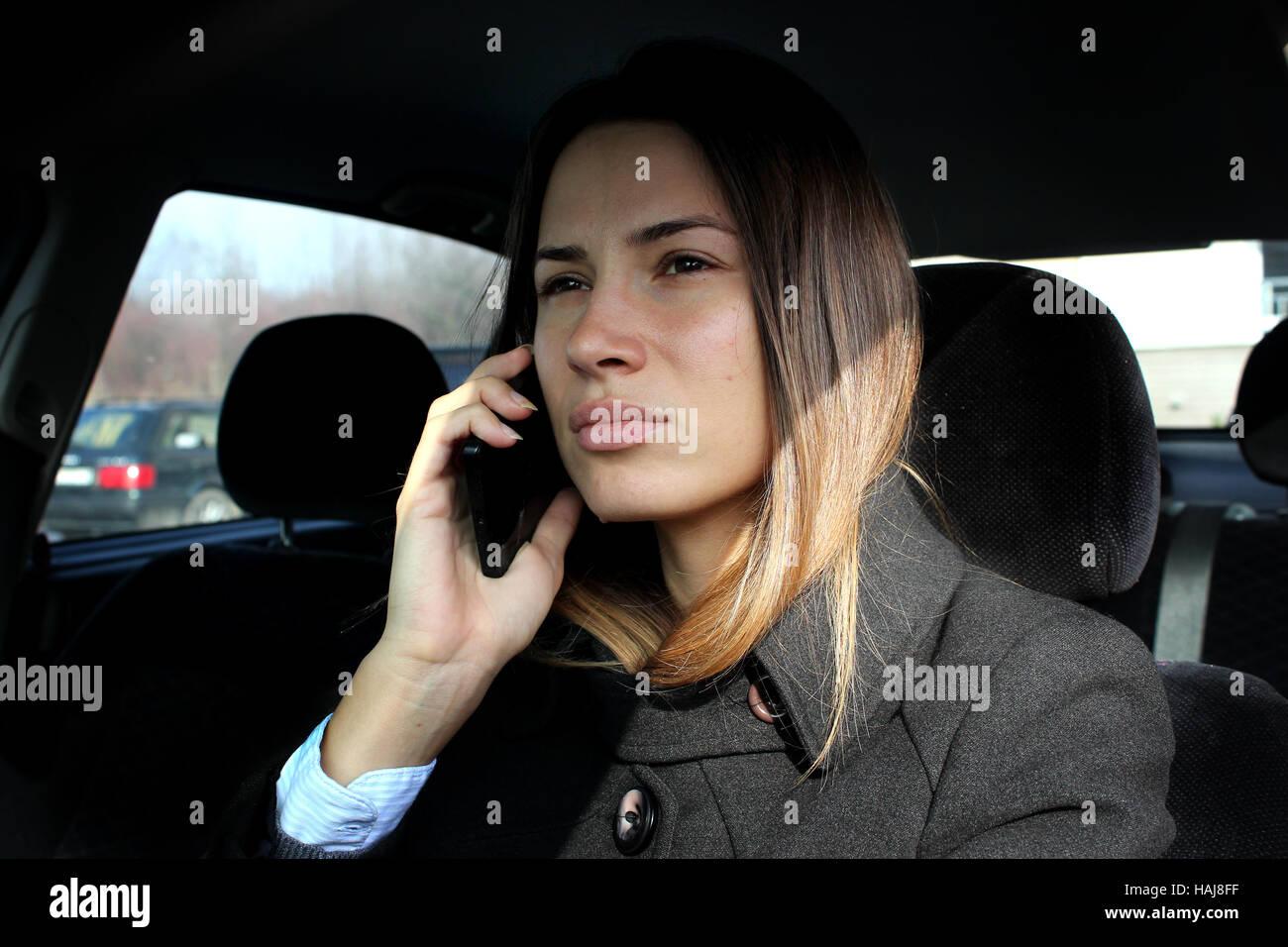 Girl car telephon - Stock Image