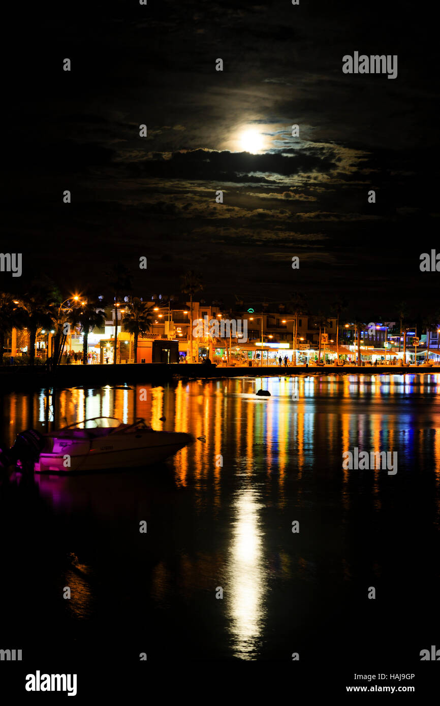 Night time with 'Supermon' rising over Paphos Harbour,Cyprus - Stock Image