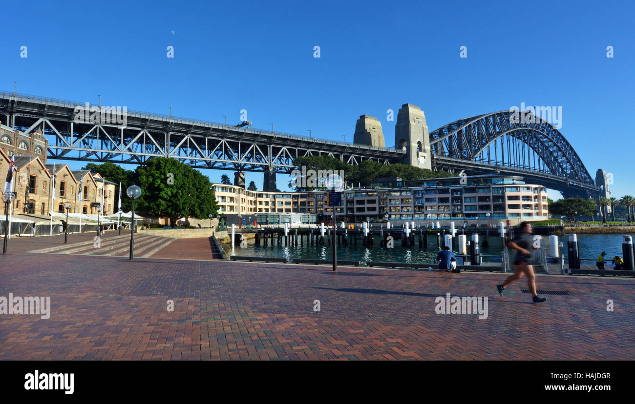 Sydney Harbour Bridge as view from The Rocks Sydney Cove at sunrise in Sydney, Australia. - Stock Image